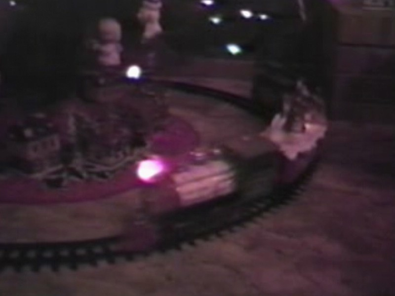 Video Archive Clip 1990 (Dec) - Yaden, Dan & Julie (both age 36) - Christmas Tree Train & Other Christmas Things - Beaton Lake Estates Home - Corsicana, TX - Danny (age 12), Matthew (age 9), Jacob (age 6), Steven (age 2), Alex (age 8 mos) - Mixed Relations Series - Edited in January 1991 (4 min 21 sec)